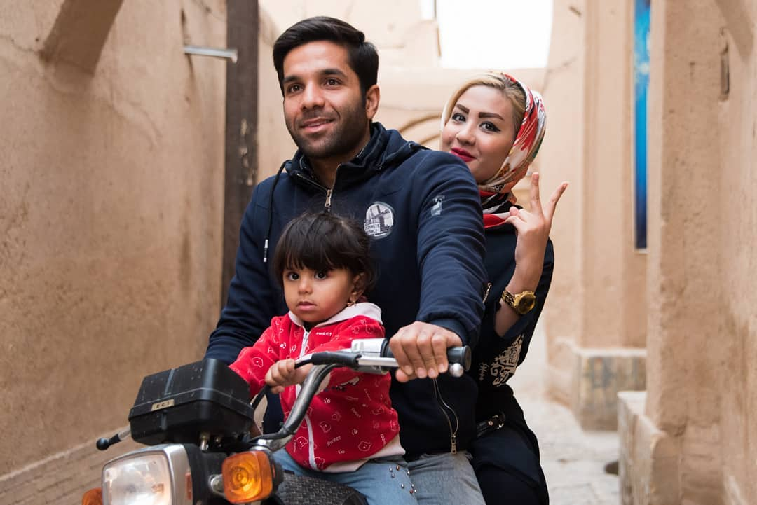 Beautiful Family of 3 on a Motorbike in Yazd