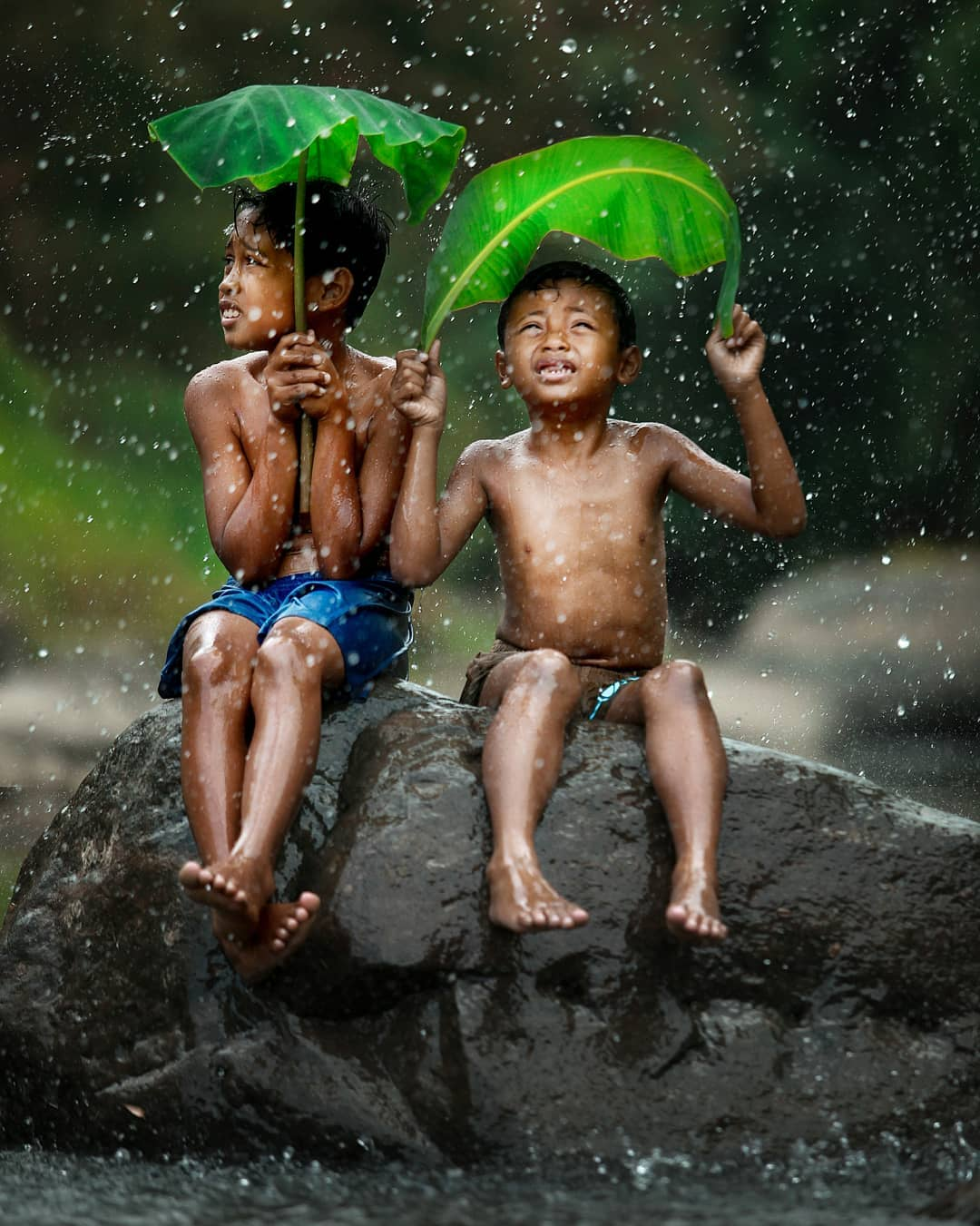Indonesia Kids Take Shelter from the Rain