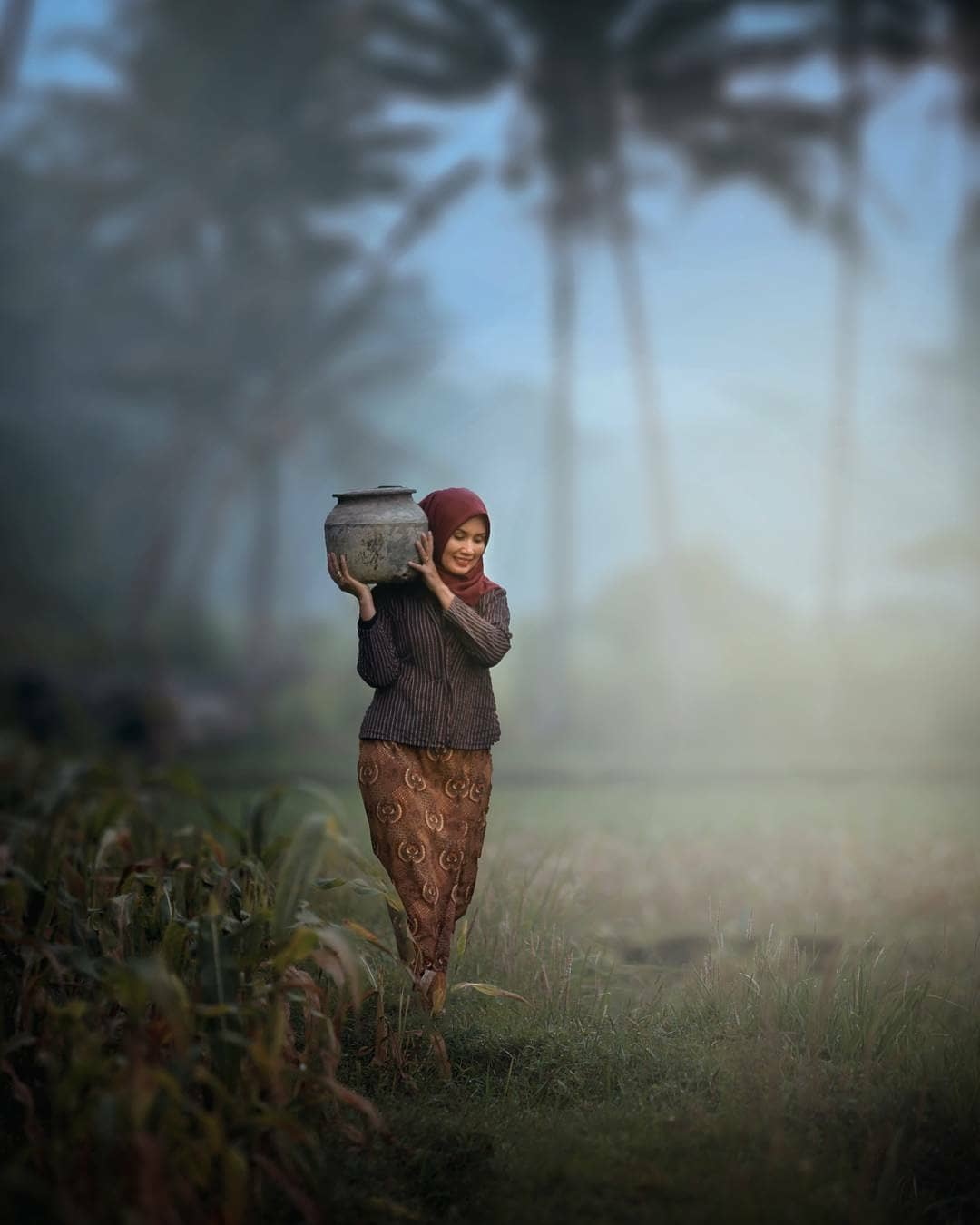 Indonesian Woman Carries Vase
