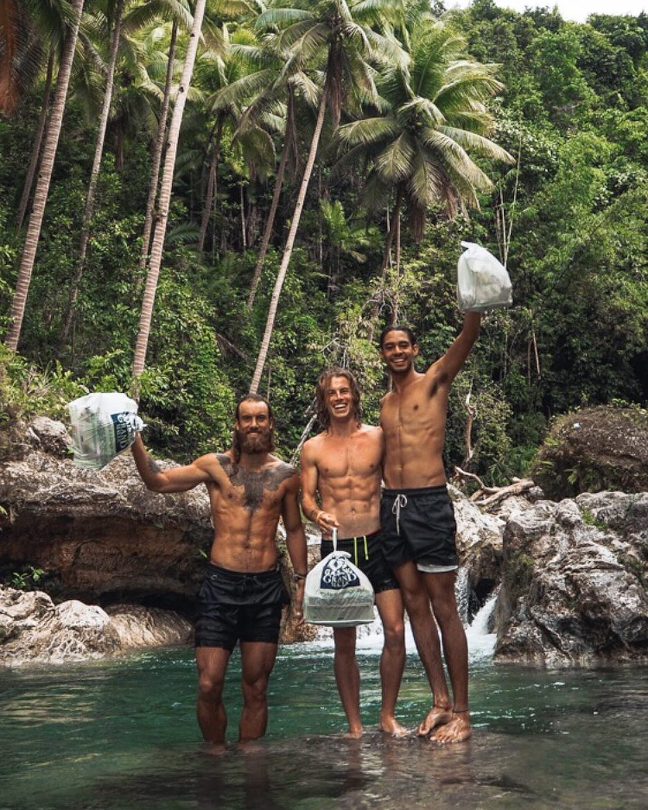 Jackson Pictured with Friends each Carrying an Adventure Bag